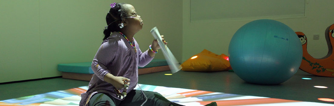 photo: young girl playing courtesy of Haven House Children's Hospice